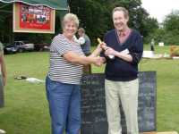 Patsy presenting James with his prize